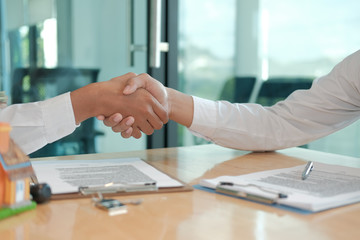 client shaking hands to realtor mortgage insurance broker lawyer. customer handshaking with financial advisor for advice, making investment deal