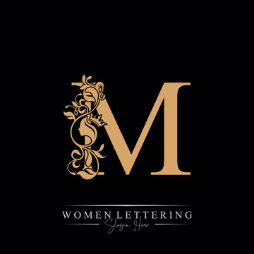 Initial letter Luxury M logo with beautiful woman portrait. Leaf Ornament Luxury glamour concept.