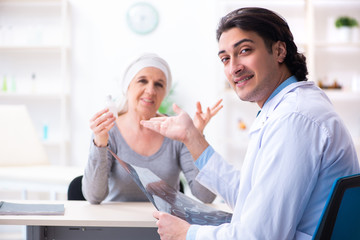 Young male doctor and female oncology patient