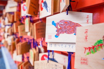 Kyoto, Japan - March. 22, 2019: Beautiful ema (Shinto, picture-horse) with wishes in Fushimi Inari Taisha shrine temple, prayer from people
