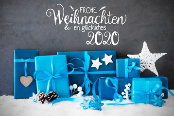 German Calligraphy Frohe Weihnachten Und Ein Glueckliches 2020 Means Merry Christmas And A Happy 2020. Turquoise Gift With Bow And Christmas Decoration. Black Background With Snow