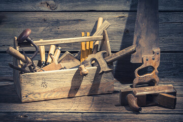 Closeup of joinery tool box in rustic wooden shed