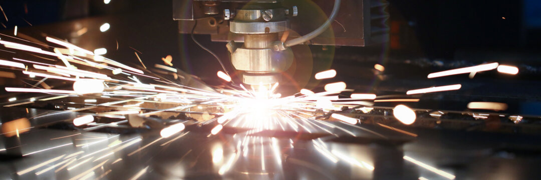 Laser metall cut cnc machine. Fly fire sparks background.