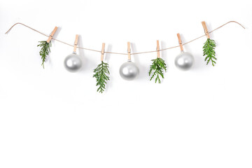 Christmas composition on a white background. Sisal string, fir twigs, Christmas balls, place for...