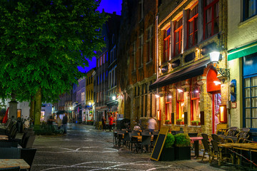 Old street in Bruges (Brugge), Belgium. Night cityscape of Bruges. Typical architecture of Bruges