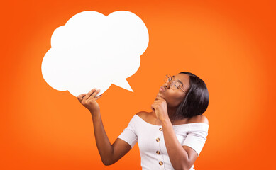 Young Black Woman Holding Speech Bubble Standing, Orange Background, Mockup