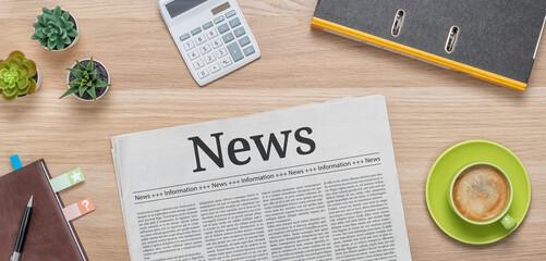 A newspaper on a desk with the headline News