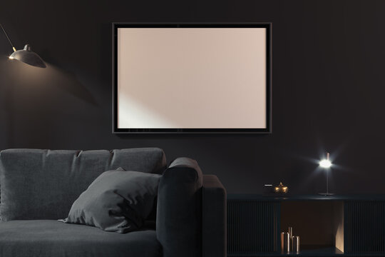 Transparent photo frame with blank poster on dark walls near black couch, 3d rendering. Living room modern interior.