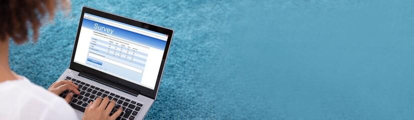 Woman Filling Survey Form On Digital Tablet