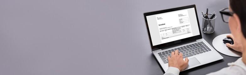 Close-up Of Businesswoman Using Digital Laptop Preparing Invoice
