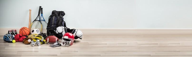 Fototapeta Different Type Of Sports Equipment On Wooden Desk obraz
