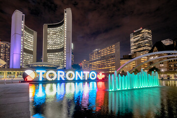 Printed roller blinds Toronto Nathan Phillips Square at night with Toronto Sign and City Hall Building