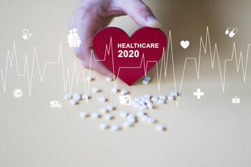 Doctor pushing button 2020 healthcare on virtual panel medicine.