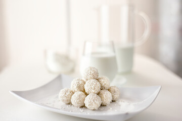 Chocolate candies in coconut pralines with milk