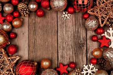 Wall Mural - Red and gold Christmas ornament frame. Top view on a rustic wood background.