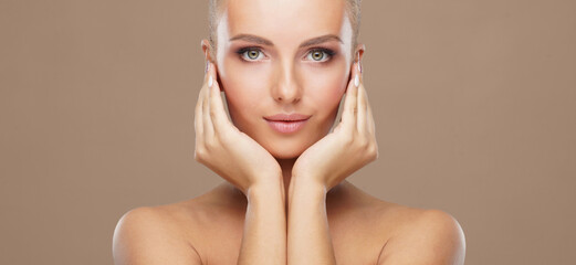Foto op Aluminium Spa Beautiful face of young and healthy woman. Skin care, cosmetics, makeup, complexion and face lifting.