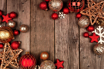 Wall Mural - Red and gold Christmas ornament double corner border. Top view on a rustic wood background.