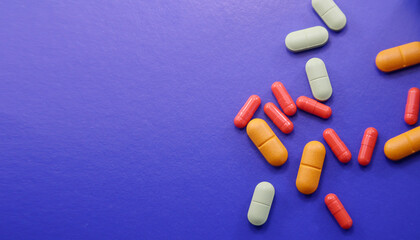 Assorted pharmaceutical medicine pills, tablets and capsules.Pills background. Heap of assorted various medicine tablets and pills different colors on background. Health care Wall mural
