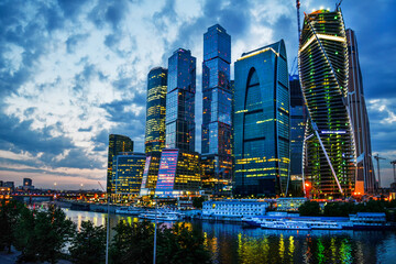 Tuinposter Moskou Majestic view on Moscow-city - Sunset.Moscow riveк . Russian group of skyscrapers- very long built and not finished to now