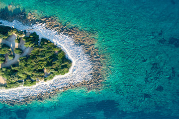 Photo sur Aluminium Bleu vert Aerial view of sea and beach in a lagoon on Cres ( isola Cherso ) Island Croatia, close to Punta Kriza ( Punta Croce ). It is a part of national where rocks and sand and forest merge on a coast.