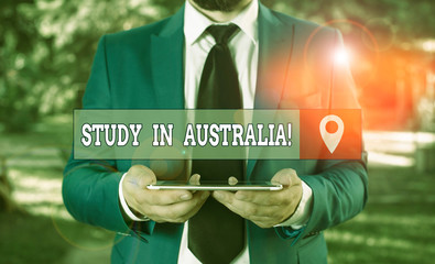 Writing note showing Study In Australia. Business concept for going into foreign country order...