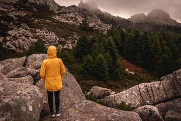 Woman observing the Mountain landscape of Sardinia, Monte Limbara, Olbia-Tempio.