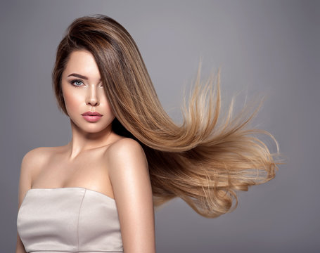 Young woman with long straight hair. Blond girl.