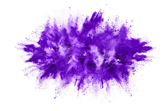 Powder explosion. Closeup of a purple dust particle explosion isolated on white. Abstract background.