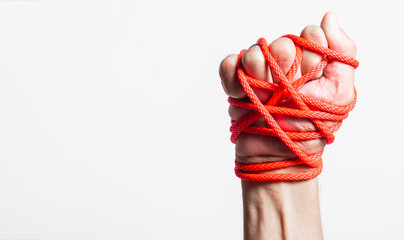 Red Rope on fist hand on white background, Human rights day concept