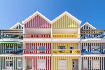 Street with colorful houses in Costa Nova, Aveiro, Portugal. Street with striped houses, Costa Nova, Aveiro, Portugal. Facades of colorful houses in Costa Nova, Aveiro, Portugal