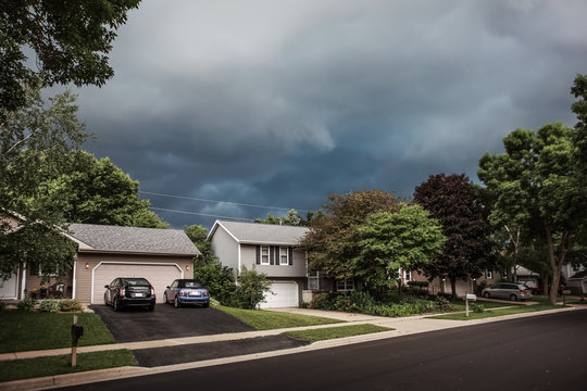 Thunderstorm clouds over a suburban neighborhood