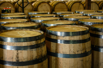 Fototapete - Empty Bourbon Barrels Await Filling