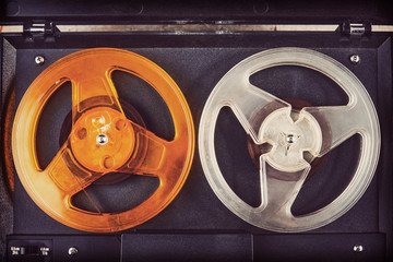 Closeup of a reel to reel audio tape recorder