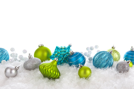 Green and Teal Christmas ornaments isolated on white