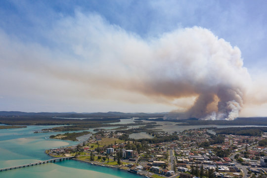 the town of Tuncurry on the new south wales north coast drone with bush fire out of control in bushland.