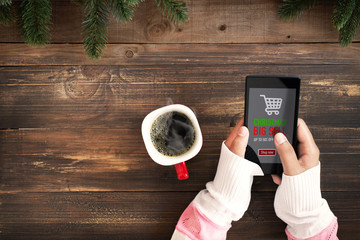 Hand of female using mobile phone to online shopping. Christmas and New Year holiday online shopping concept. Big sale in winter holiday.