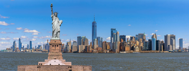 The Statue of Liberty over the Panorama Scene of New York cityscape river side which location is lower manhattan, United state of America, USA, Architecture and building with tourist concept