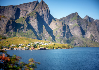 Wall Mural - Beautiful northern landscape, Lofoten islands in Norway. Village at the foot of high cliffs