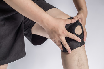 LWTWL0007501 Close-up Of A Man Wearing Knee Brace Over White Background