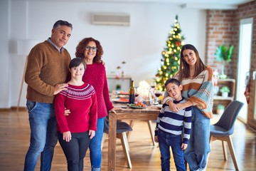 Beautiful family smiling happy and confident. Standing and posing around christmas treeat home