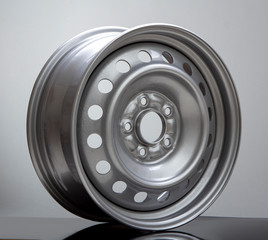 Steel wheel rim on grey background