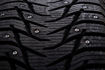 Winter studded car tire with snow spikes