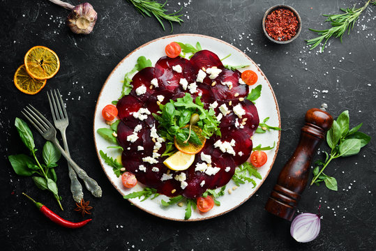 Beet vegetable salad with feta cheese. Food. Top view. Free space for your text.