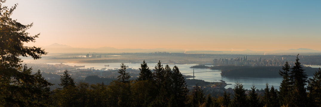A sunrise view of downtown Vancouver, Stanley Park, and the Lions Gate Bridge as seen from Cypress Mountain.
