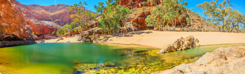 Banner panorama of Ormiston Gorge Water Hole with ghost gum in West MacDonnell Ranges, Northern...