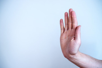 Defense or stop gesture: Male hand with stop gesture