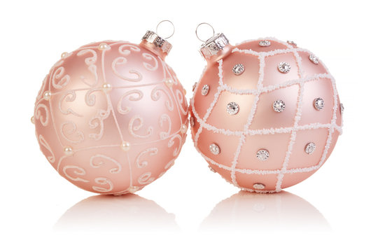 Two pink christmas balls on white background, xmas baubles