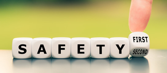 "Hand turns a dice and changes the expression ""safety second"" to ""safety first"""