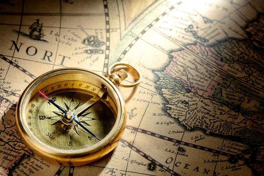 antique compass on ancient map dated 1460AD