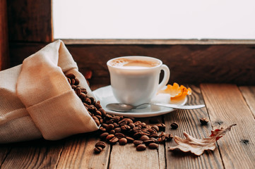 coffee Cup with beans on wooden background